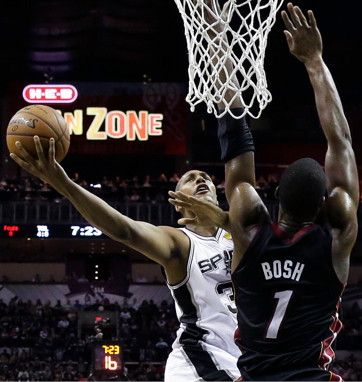 . San Antonio Spurs forward Boris Diaw shoots as Miami Heat center Chris Bosh (1) defends during the first half in Game 2 of the NBA basketball finals on Sunday, June 8, 2014, in San Antonio. (AP Photo/Eric Gay)