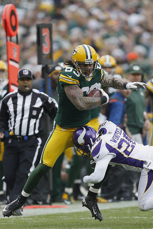 . Tom Crabtree #83 of the Green Bay Packers is tackled by Antoine Winfield #26 of the Minnesota Vikings at Lambeau Field on December 2, 2012 in Green Bay, Wisconsin.  The Packers defeated the Vikings 23-14.  (Photo by Wesley Hitt/Getty Images)