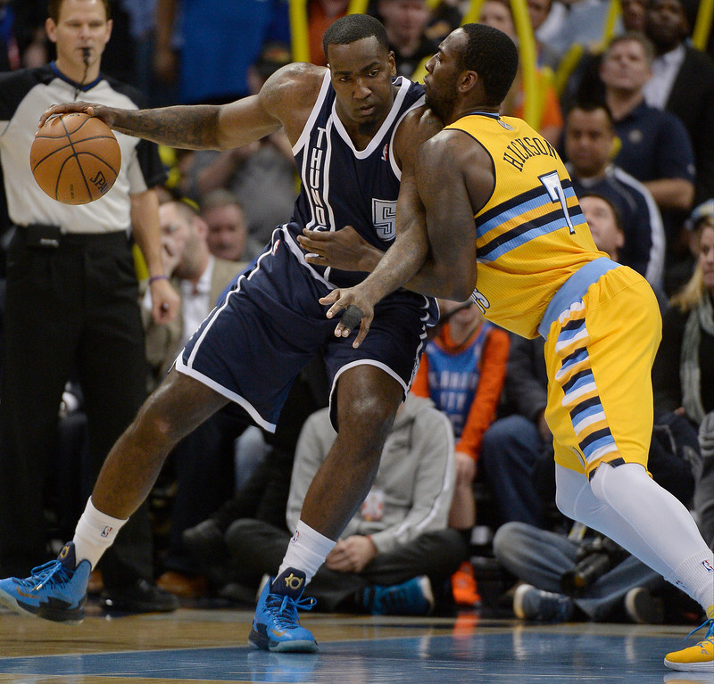 . Oklahoma City Thunder center Kendrick Perkins (5) tries to back in on Denver Nuggets power forward J.J. Hickson (7) during the first quarter January 9, 2014 at Pepsi Center. (Photo by John Leyba/The Denver Post)