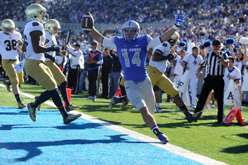 . COLORADO SPRINGS, CO - OCTOBER 26: Air Force WR, Colton Huntsman, right, celebrates his touch down against Notre Dame, in the first quarter of play at Falcons Stadium Saturday afternoon, October 26, 2013. (Photo By Andy Cross/The Denver Post)