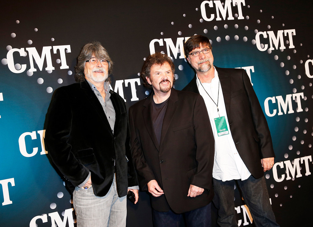 """. Alabama, from left, Randy Owen, Jeff Cook and Teddy Gentry pose on the red carpet at the CMT \""""Artists of the Year\"""" event at Bridgestone Arena, on Tuesday, December 3, 2013, in Nashville, Tenn. (Photo by Donn Jones/Invision/AP)"""