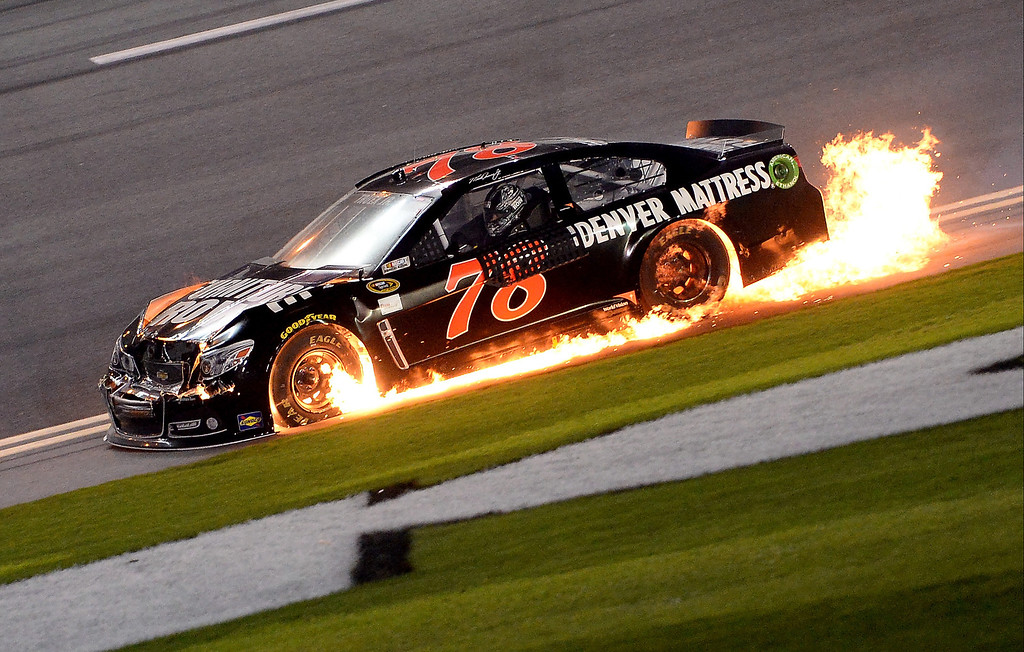 . Martin Truex Jr., driver of the #78 Furniture Row Chevrolet, is involved in an incident during the NASCAR Sprint Cup Series Budweiser Duel 2 at Daytona International Speedway on February 20, 2014 in Daytona Beach, Florida.  (Photo by Patrick Smith/Getty Images)