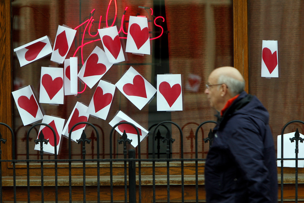 . Paper hearts hang on a window on Valentine\'s Day on Thursday, Feb. 14, 2013 in Montpelier, Vt. The annual tradition of plastering Montpelier\'s downtown with valentine hearts has happened again.(AP Photo/Toby Talbot)