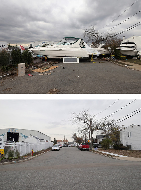 . MERRICK, NY - NOVEMBER 01: (top) A boat from the Blue Water Club blocks Whaleneck Drive in the aftermath of Superstorm Sandy on November 1, 2012 in Merrick, New York. Superstorm Sandy, which has left millions without power or water, continues to effect business and daily life throughout much of the eastern seaboard. MERRICK, NY - OCTOBER 22: (bottom) Cars sit parked on Whaleneck Drive, which had been littered with boats after Superstorm Sandy on October 22, 2013 in Merrick, New York. Hurricane Sandy made landfall on October 29, 2012 near Brigantine, New Jersey and affected 24 states from Florida to Maine and cost the country an estimated $65 billion. (Photos by Bruce Bennett/Getty Images)