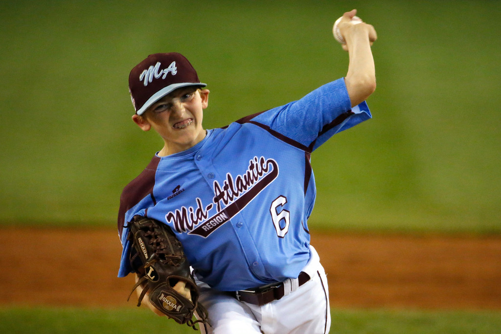 . Philadelphia\'s Erik Lipson (6) delivers during the first inning of an elimination baseball game against Chicago at the Little League World Series tournament in South Williamsport, Pa., Thursday, Aug. 21, 2014. (AP Photo/Gene J. Puskar)