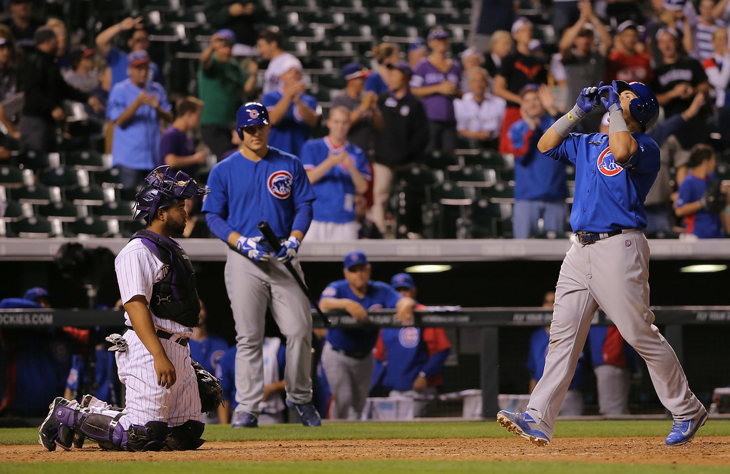 . DENVER, CO - AUGUST 05:  Javier Baez #9 of the Chicago Cubs celebrates his game winning solo home run off of Boone Logan #48 of the Colorado Rockies in the 12th inning at Coors Field on August 5, 2014 in Denver, Colorado. The Cubs defeated the Rockies 6-5 in 12 innings.  (Photo by Doug Pensinger/Getty Images)
