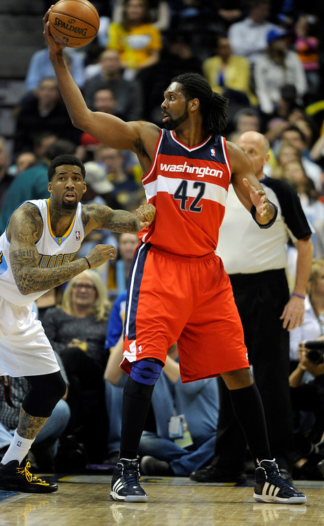 . DENVER, CO - JANUARY 18: Washington forward Nene worked against Denver forward Wilson Chandler in the first half. The Denver Nuggets hosted the Washington Wizard at the Pepsi Center Friday night, January 18, 2013. Karl Gehring/The Denver Post