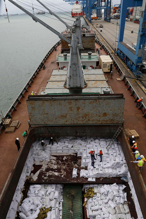 ". Bags labeled ""Cuban Raw Sugar\"" are seen inside a North Korean flagged ship \""Chong Chon Gang\"" docked at the Manzanillo Container Terminal in Colon City July 16, 2013. REUTERS/Carlos Jasso"