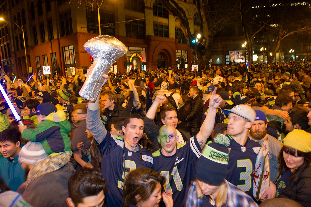 . Seattle Seahawks fans celebrate their team\'s 43-8 victory over the Denver Broncos in Super Bowl XLVIII in downtown Seattle, Washington, USA, 02 February 2014.  EPA/DAN LEVINE