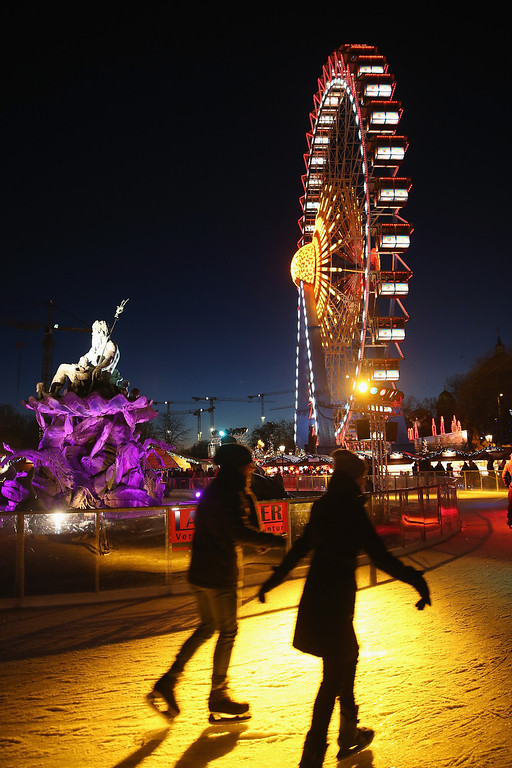 . Visitors skate at an ice rink at the Christmas market at Alexanderplatz square under an illuminated ferris wheel on November 26, 0213 in Berlin, Germany.   (Photo by Sean Gallup/Getty Images)