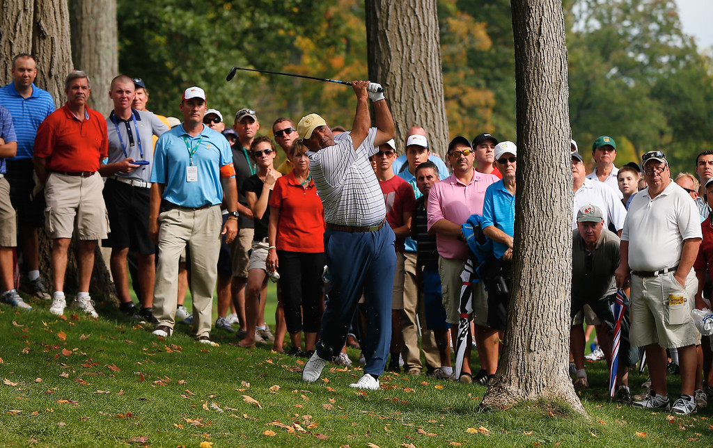 . DUBLIN, OH - OCTOBER 05:  Angel Cabrera of Argentina and the International Team hits a shot from the rough on the 15th hole during the Day Three Four-ball Matches at the Muirfield Village Golf Club on October 5, 2013  in Dublin, Ohio.  (Photo by Matt Sullivan/Getty Images)