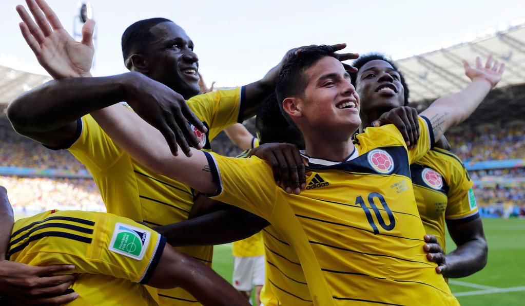. Colombia\'s James Rodriguez (10) celebrates with his teammates after scoring his side\'s third goal during the group C World Cup soccer match between Colombia and Greece at the Mineirao Stadium in Belo Horizonte, Brazil, Saturday, June 14, 2014. Colombia defeated Greece 3-0. (AP Photo/Fernando Vergara)