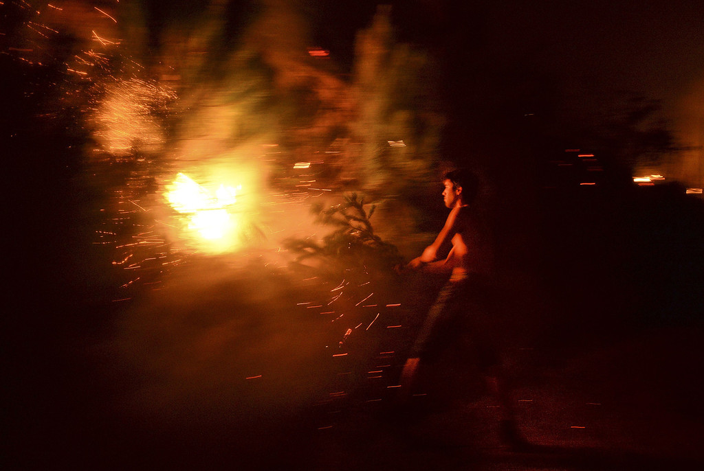 . A man tries to extinguish a wildfire approaching houses in Santiago de Besteiros, near Caramulo, central Portugal, early on August 30, 2013.   AFP PHOTO / PATRICIA DE MELO MOREIRA/AFP/Getty Images