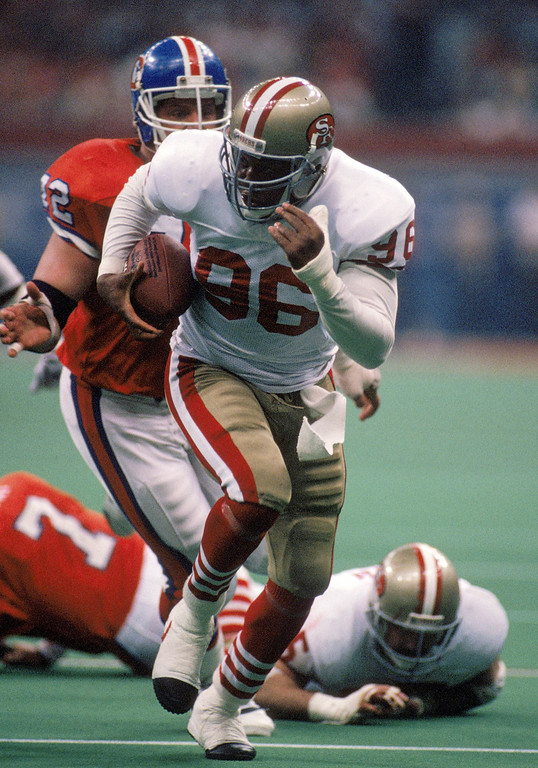 . Defensive end Daniel Stubbs #96 of the San Francisco 49ers returns a fumble in Super Bowl XXIV against the Denver Broncos at Louisiana Superdome on January 28, 1990 in New Orleans, Louisiana.  The 49ers won 55-10.  (Photo by George Rose/Getty Images)