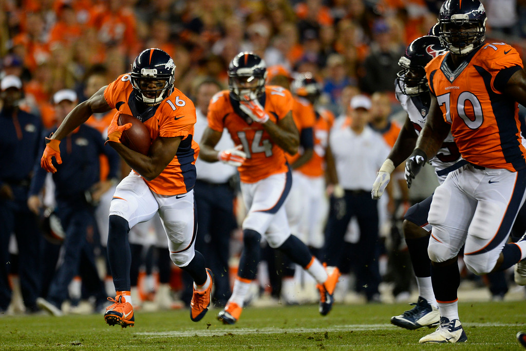 . DENVER, CO - AUGUST 23:  Bennie Fowler (16) of the Denver Broncos carries the ball against the Houston Texans during a preseason football game at Sports Authority Field at Mile High on Saturday, August 23, 2014 in Denver, Colorado.  (Photo by Kent Nishimura/The Denver Post)