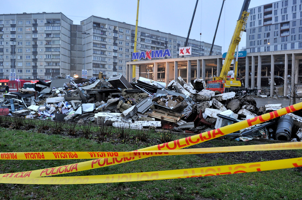 . Debris, foreground,which was removed by rescue teams during a search for victims at the Maxima supermarket in Riga, Latvia, Friday, Nov. 22, 2013. (AP Photo/ Roman Koksarov)