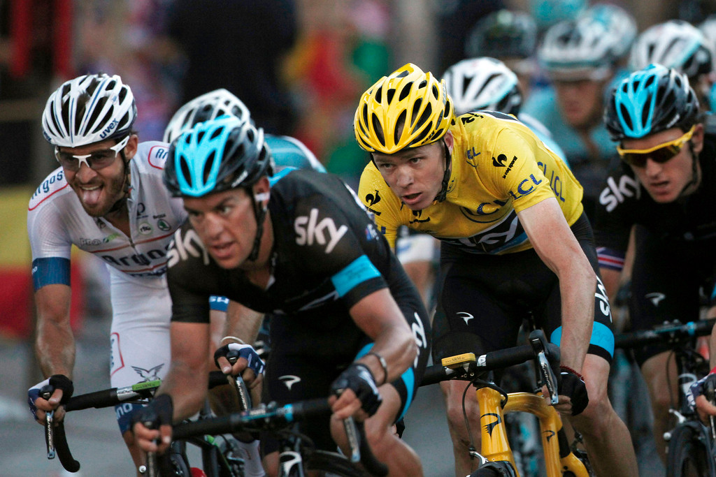 . Christopher Froome of Britain, wearing the overall leader\'s yellow jersey, rides in the pack during the 21st and last stage of the 100th edition of the Tour de France cycling race over 133.5 kilometers (83.4 miles) with start in Versailles and finish in Paris, France, Sunday July 2, 2013. (AP Photo/Thibault Camus)