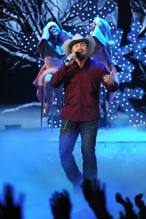 ". In this publicity photo released by FOX, finalist, Tate Stevens, performs  during ""The X Factor\"" Finale, on Thursday, Dec. 20, 2012 (8:00-9:00PM ET/PT) on FOX.  (AP Photo/FOX, Ray Mickshaw)"