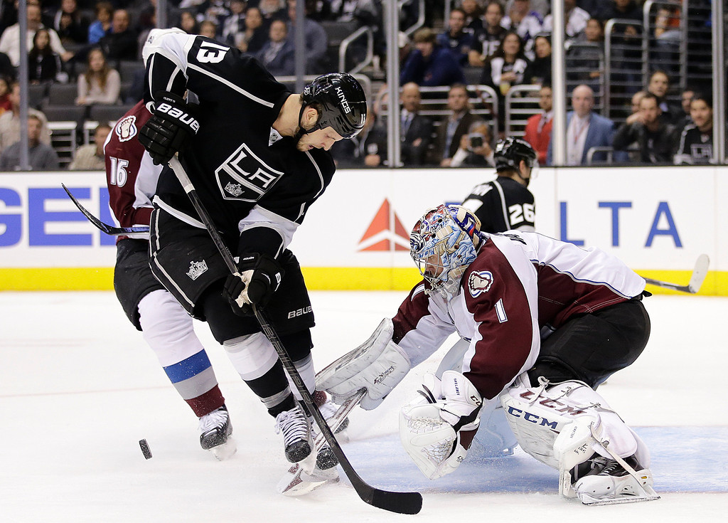 . Colorado Avalanche goalie Semyon Varlamov, right, of Russia, makes a save in front of Los Angeles Kings\' Kyle Clifford during the second period of an NHL hockey game on Saturday, Nov. 23, 2013, in Los Angeles.(AP Photo/Jae C. Hong)