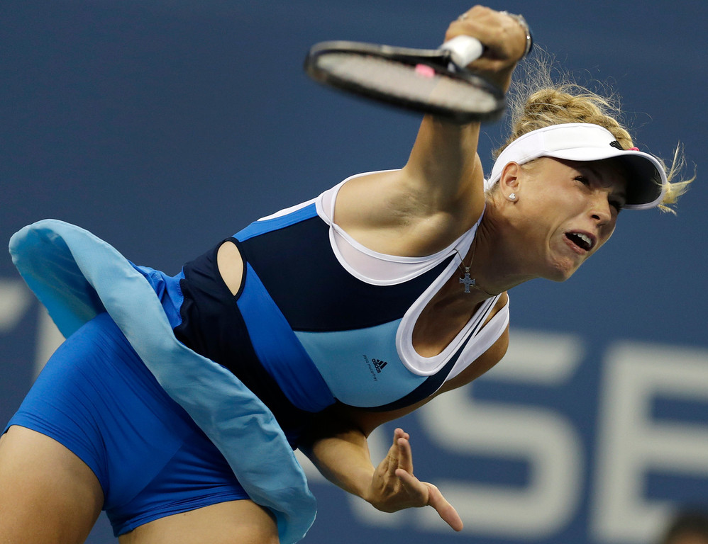 . Caroline Wozniacki, of Denmark, serves against Chanelle Scheepers, of South Africa, during the second round of the 2013 U.S. Open tennis tournament, early Thursday, Aug. 29, 2013, in New York. (AP Photo/Charles Krupa)