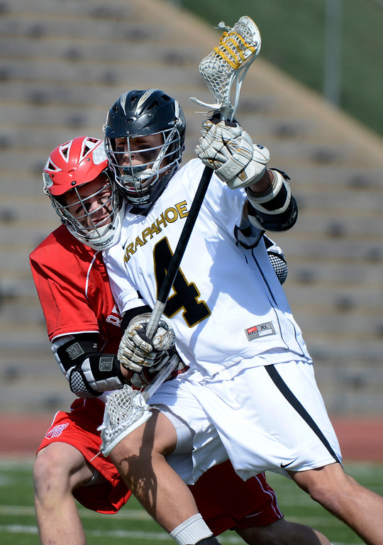 . LITTLETON, CO. - MAY 04:  Arapahoe\'s Tyler Lampard crashes into Regis Jesuit\'s Alec Barnes during the varsity high school lacrosse game between the Arapahoe Warriors and the Regis Jesuit Raiders in Littleton, CO May 04, 2013. The Raiders won the game 9-6.  (Photo By Craig F. Walker/The Denver Post)
