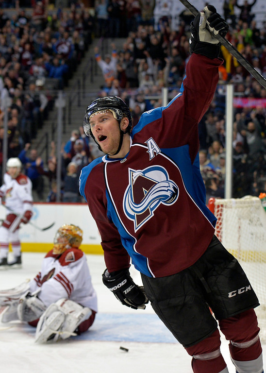 . Colorado Avalanche center Paul Stastny celebrates a goal against Phoenix Coyotes goalie Thomas Greiss during the third period of an NHL hockey game on Friday, Feb. 28, 2014, in Denver. (AP Photo/Jack Dempsey)