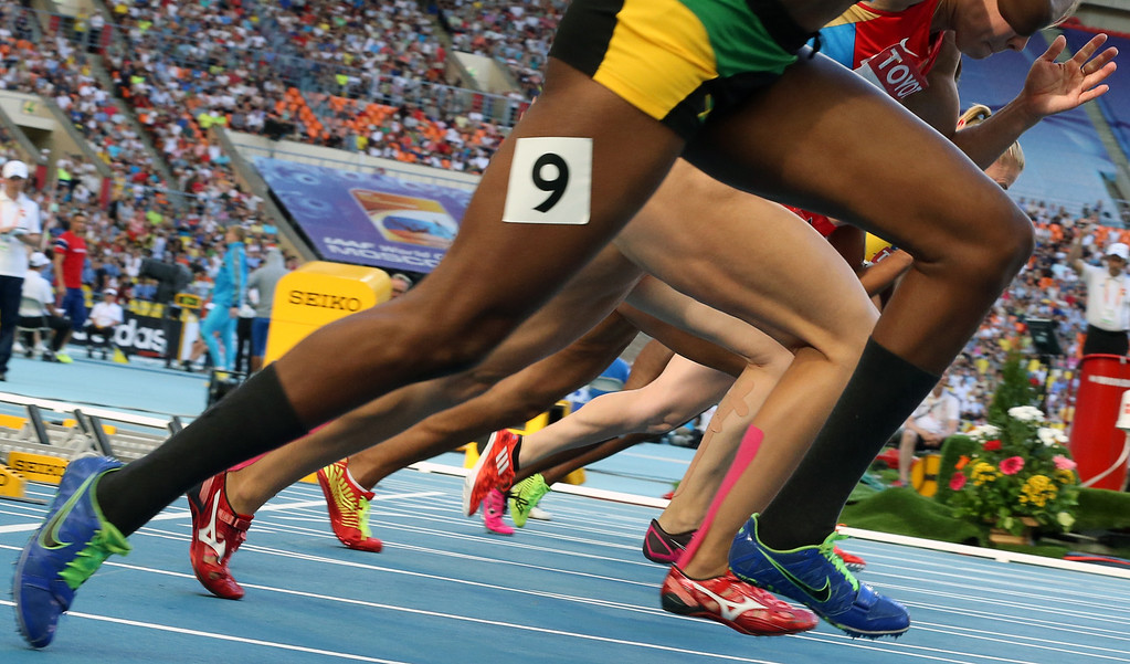 . Athletes compete during the women\'s 100 metres hurdles semi-final at the 2013 IAAF World Championships at the Luzhniki stadium in Moscow on August 17, 2013.  ALEXANDER NEMENOV/AFP/Getty Images