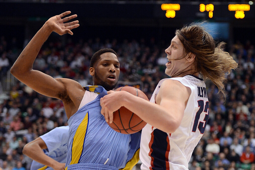 . SALT LAKE CITY, UT - MARCH 21:  Kelly Olynyk #13 of the Gonzaga Bulldogs with the ball against Brandon Moore #32 of the Southern University Jaguars in the first half during the second round of the 2013 NCAA Men\'s Basketball Tournament at EnergySolutions Arena on March 21, 2013 in Salt Lake City, Utah.  (Photo by Harry How/Getty Images)