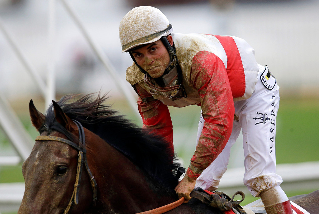 . Orb, with jockey Joel Rosario aboard, gallops back to the paddock after the 138th Preakness Stakes horse race at Pimlico Race Course, Saturday, May 18, 2013, in Baltimore. Oxbow won the race, Orb, the Kentucky Derby winner, finished fourth. (AP Photo/Patrick Semansky)