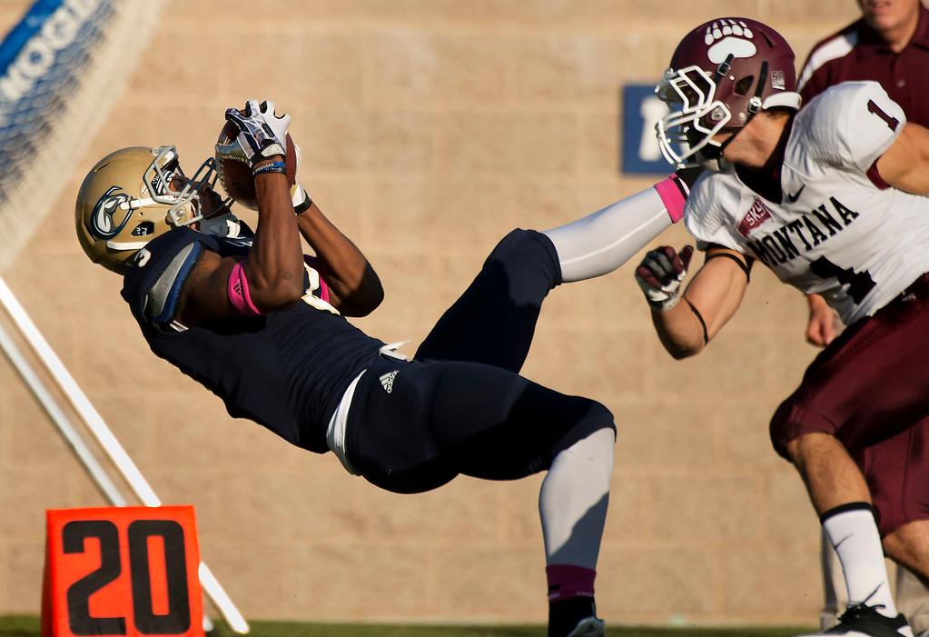 . UC Davis wide receiver TJ King (3) catches a long pass during an NCAA college football game Saturday, Oct. 12, 2013, in Davis, Calif. (AP Photo/The Sacramento Bee, Randall Benton)