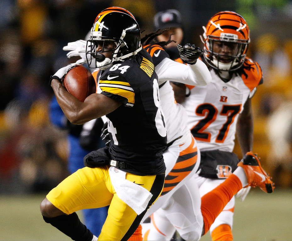 . Antonio Brown #84 of the Pittsburgh Steelers heads up field after getting around the tackle of Dre Kirkpatrick #27 of the Cincinnati Bengals after a fist quarter reception at Heinz Field on December 15, 2013 in Pittsburgh, Pennsylvania.  (Photo by Gregory Shamus/Getty Images)