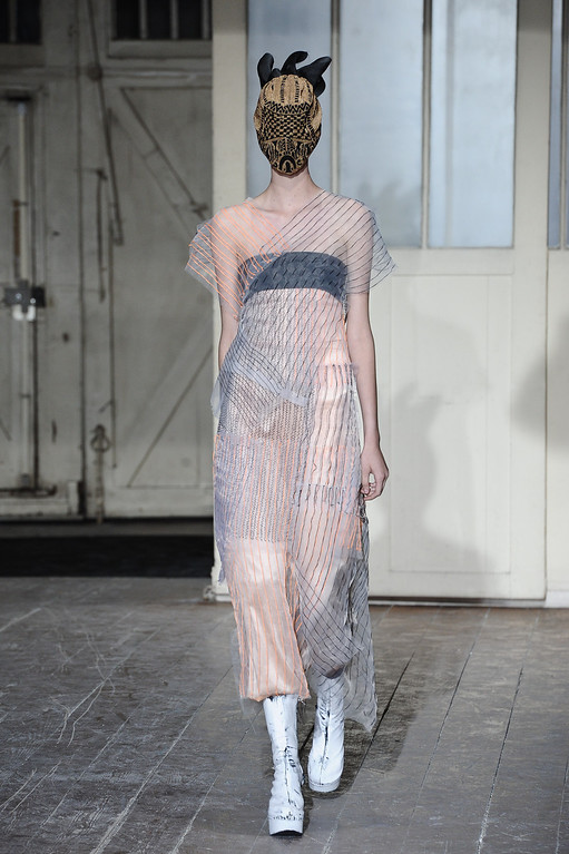 . A model wears a creation by fashion designer Martin Margiela as part of his Spring/Summer 2013 Haute Couture fashion collection, in Paris, Wednesday, Jan. 23, 2013. (AP Photo/Zacharie Scheurer)