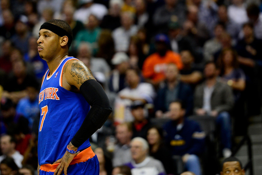 . DENVER, CO - MARCH 13: Carmelo Anthony (7) of the New York Knicks takes a moment against the Denver Nuggets during the first half of action. The Denver Nuggets play the New York Knicks at the Pepsi Center. (Photo by AAron Ontiveroz/The Denver Post)