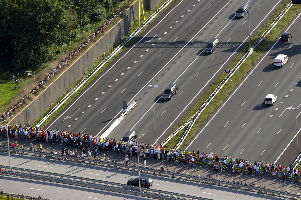 . An aerial view shows people standing on a bridge looking at a convoy of hearses carry the remains of the victims of the Malaysia Airlines flight MH17 plane crash from an airbase in Eindhoven to Hilversum, The Netherlands, and driving through Den Bosch on July 24, 2014, after a Dutch Air Force C-130 Hercules plane and an Australian Royal Australian Air Force C17 transporting the remains arrived from Kharkiv, Ukraine. Dozens more bodies from the crash site of Malaysia Airlines flight MH17 are set to arrive in the Netherlands today as the EU prepares to hit Russia with fresh sanctions. AFP PHOTO / ANP / BRAM VAN DER BIEZEN /AFP/Getty Images