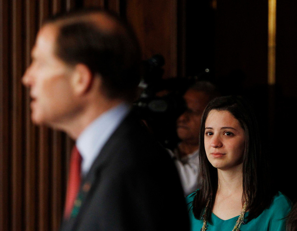 . Jillian Soto (R) listens to U.S. Senator Richard Blumenthal (D-CT) at a news conference for family members of gun violence victims in Washington April 11, 2013. Soto\'s sister Victoria, was a first grade teacher at Sandy Hook Elementary School who was killed in last December\'s massacre. The U.S. Senate cleared the way on Thursday for an emotional, weeks-long debate on proposals to curb gun violence, rejecting an effort by conservative Republicans to block consideration of gun-control legislation prompted by December\'s Newtown school massacre.  REUTERS/Gary Cameron
