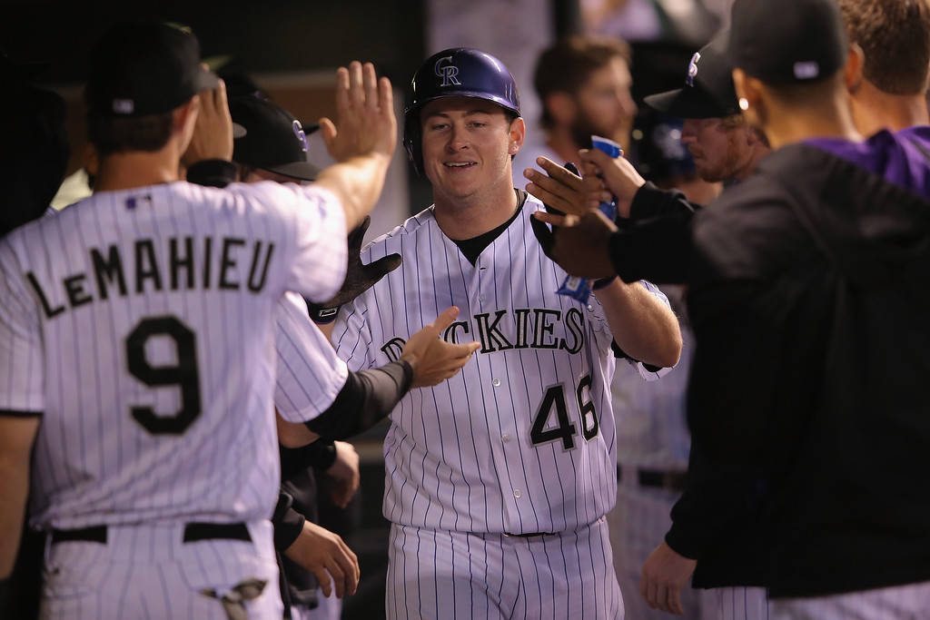 . Starting pitcher Tyler Matzek #46 of the Colorado Rockies celebrates in the dugout after he scored on a single by Troy Tulowitzki #2 of the Colorado Rockies to give the Rockies a 7-0 lead over the Atlanta Braves in the seventh inning at Coors Field on June 11, 2014 in Denver, Colorado.  (Photo by Doug Pensinger/Getty Images)