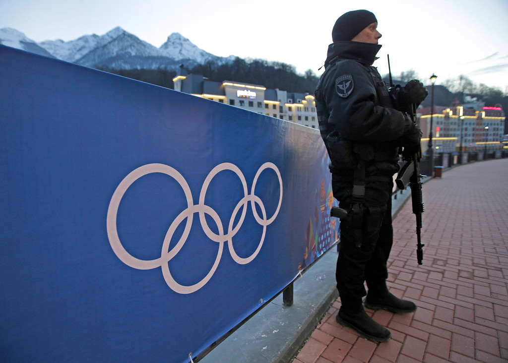 . An armed Russian security guard stands at the ski resort Rosa Khutor, where the snow and sliding sports venues for the 2014 Winter Olympics are located, Tuesday, Feb. 4, 2014, in Krasnaya Polyana, Russia. (AP Photo/Dita Alangkara)