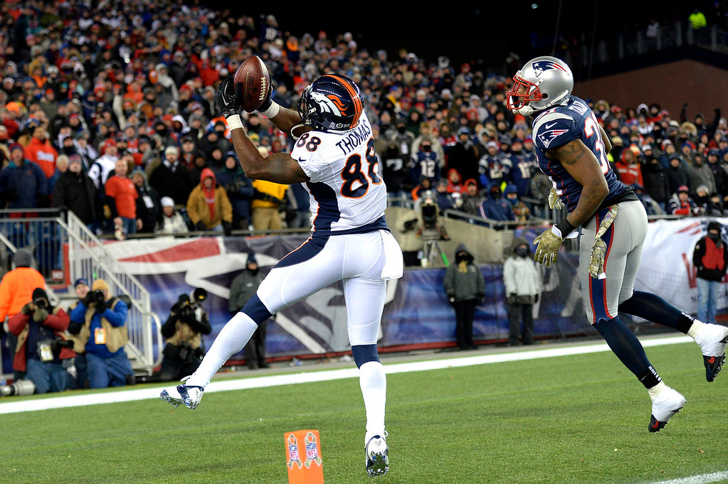 . Wide receiver Demaryius Thomas #88 of the Denver Broncos pulls in a touchdown pass in the 4th quarter to tie the game 31-31 against the New England Patriots at Gillette Stadium in Foxborough MA, November 24, 2013 Denver. (Photo By Joe Amon/The Denver Post)