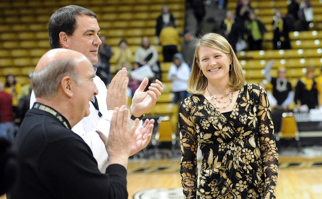 . University of Colorado coach, Linda Lappe, right, gets her 100th career coaching win against the University of New Mexico on Saturday. She is congratulated by Chancellor Phil DiStefano and AD, Mike Bohn. Cliff Grassmick / December 29, 2012