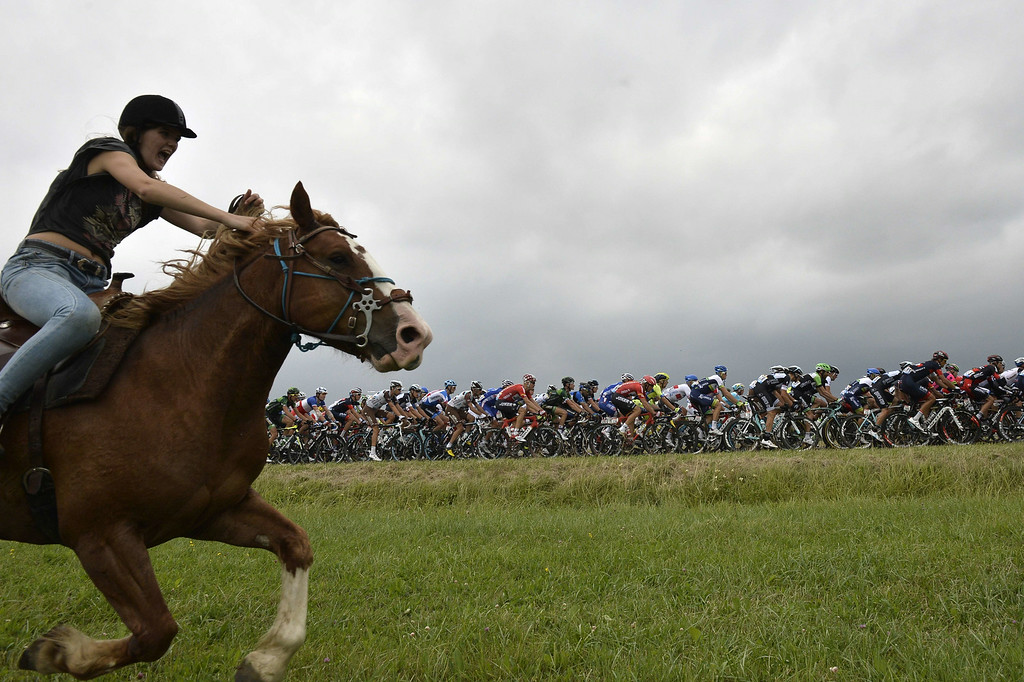 . A horse rider is pictured in front of the pack riding during the 234.5 km seventh stage of the 101st edition of the Tour de France cycling race on July 11, 2014 between Epernay and Nancy, northeastern France.  AFP PHOTO / JEFF PACHOUD/AFP/Getty Images