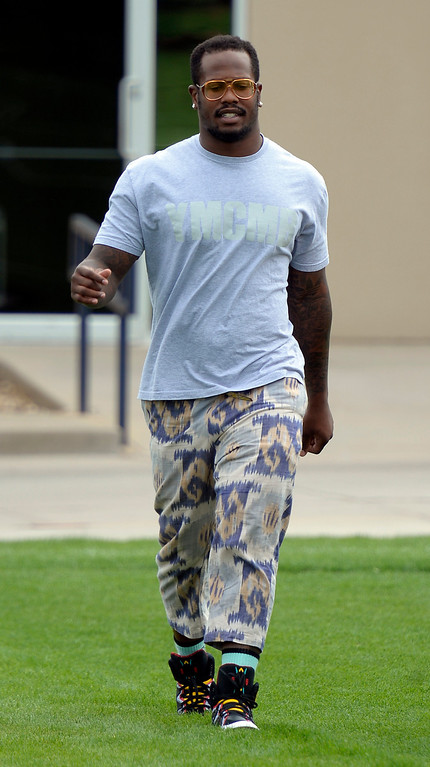 . Denver Broncos SLB Von Miller heads to the tent to meet with the media as the team reports to camp JuLY 24, 2013 at Dove Valley. (Photo By John Leyba/The Denver Post)