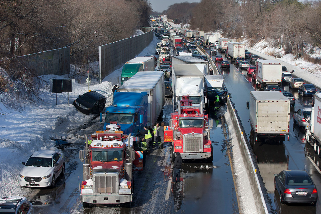 . Vehicles are piled up in an accident Friday, Feb. 14, 2014, in Bensalem, Pa. Traffic accidents involving multiple tractor trailers and dozens of cars have completely blocked one side of the Pennsylvania Turnpike outside Philadelphia and caused some injuries. (AP Photo/Matt Rourke)