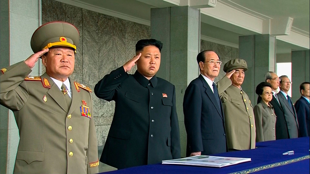 . In this image taken from video North Korean leader Kim Jong Un, second from left, salutes during a military parade marking the 65th anniversary of the country\'s founding, Monday, Sept. 9, 2013, in Pyongyang, North Korea. (AP Photo/KRT via AP Video)