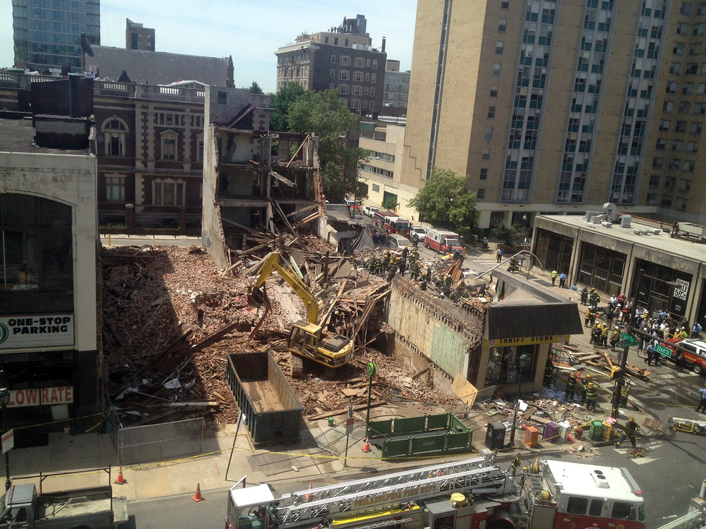 . Emergency personnel respond to a building collapse in downtown Philadelphia, where the city fire commissioner says as many as eight to 10 people are believed trapped in the rubble, Wednesday, June 5, 2013. (AP Photo/Dino Hazell)