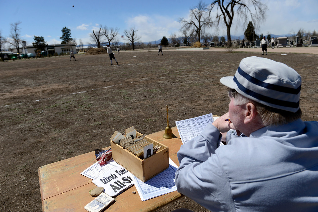 . DENVER, CO. - APRIL 14: Andy Red Regan of the  Denver Blue Stockings takes score during their vintage baseball game against the Central City Stars April 14, 2013 at  Riverside Cemetery in Denver. (Photo By John Leyba/The Denver Post)