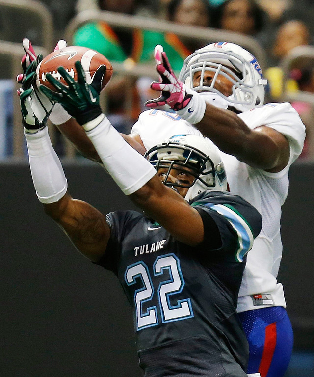 . Tulane Green Wave cornerback Jordan Sullen (22) intercepts a pass in the end zone in front of Tulsa Golden Hurricane wide receiver Jordan James in the first half of an NCAA college football game in New Orleans, Saturday, Oct. 26, 2013. (AP Photo/Bill Haber)