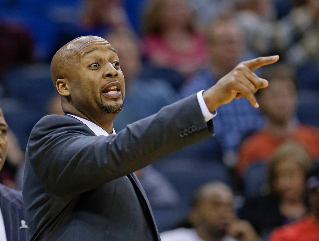 . Denver Nuggets head coach Brian Shaw directs his players against the Orlando Magic during the first half of an NBA basketball game in Orlando, Fla., Wednesday, March 12, 2014. (AP Photo/John Raoux)