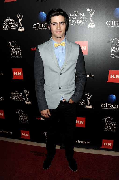 ". Max Ehrich, from ""The Young and the Restless,\"" arrives at the 40th Annual Daytime Emmy Awards on Sunday, June 16, 2013, in Beverly Hills, Calif. (Photo by Richard Shotwell/Invision/AP)"
