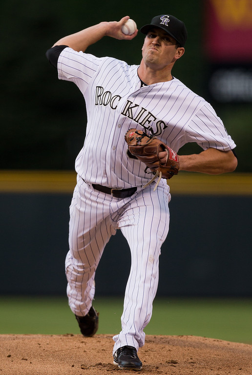 . Starting pitcher Jeff Manship #50 of the Colorado Rockies delivers to home plate during the first inning against the San Diego Padres at Coors Field on August 13, 2013 in Denver, Colorado.  (Photo by Justin Edmonds/Getty Images)