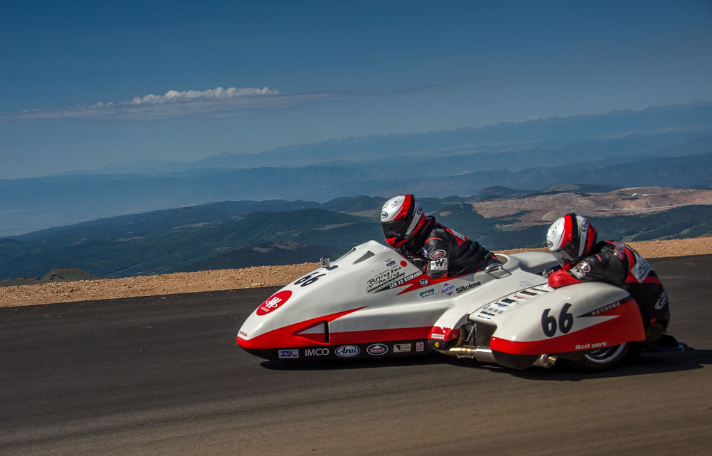 . Japanese rider Masahito Watanabe and his copilot cross the finish line at the summit of Pikes Peak mountain during The Pikes Peak International Hill Climb (PPIHC) at Pike National Forest, 10 mi (16 km) west of Colorado Springs, Colorado, on June 30, 2013. The Pikes Peak International Hill Climb (PPIHC), also known as The Race to the Clouds, an annual automobile and motorcycle hillclimb to the summit of Pikes Peak. The track measures 12.42 miles (19.99 km) over 156 turns to the finish.      JOE KLAMAR/AFP/Getty Images